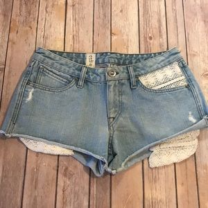 { Volcom } jean shorts with laced pockets